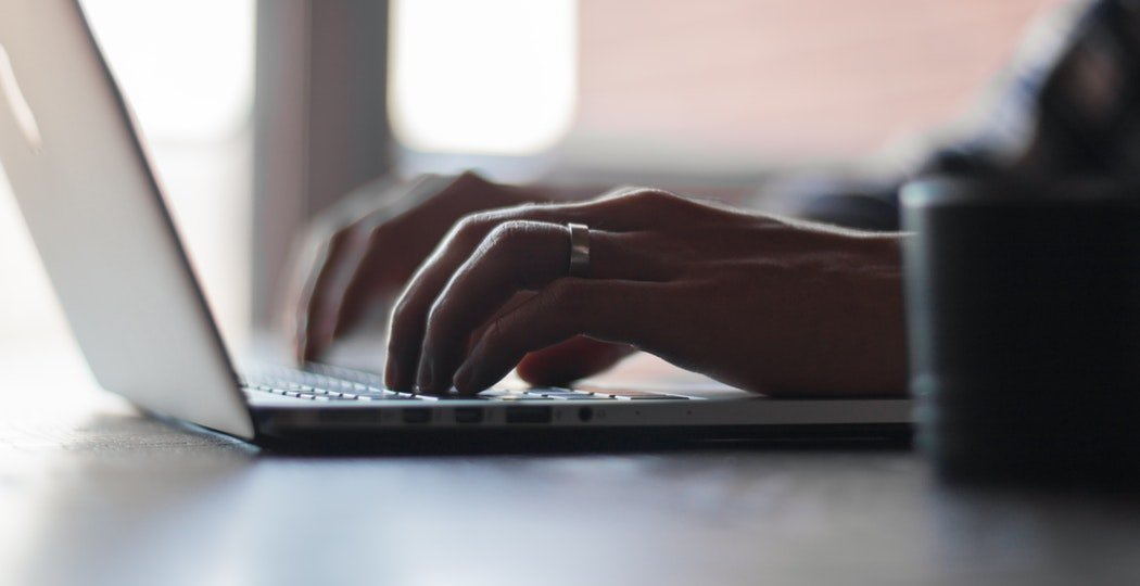 A person applying for an online personal loan on their computer