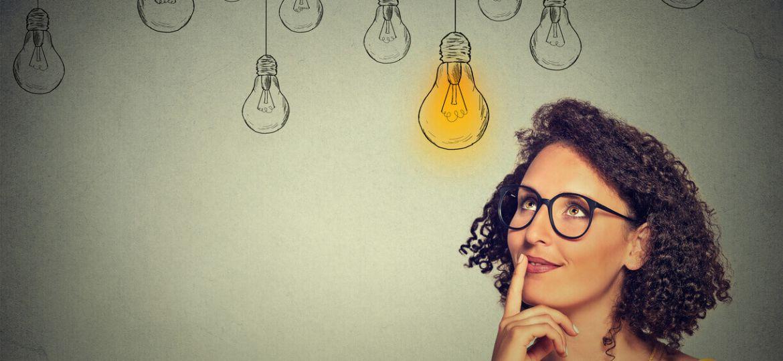 woman with drawn lightbulbs above head
