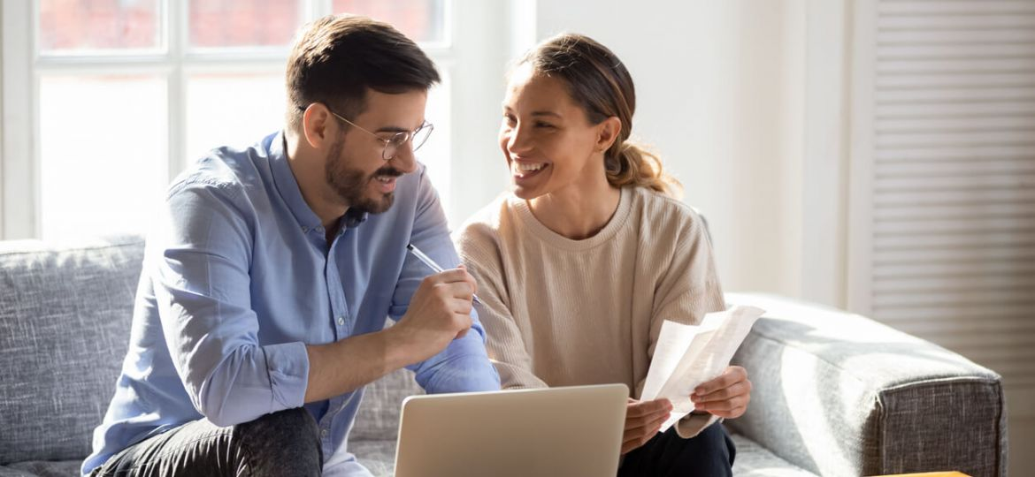couple planning a budget smiling