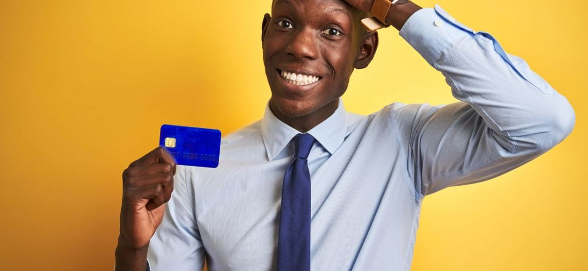 Man struggling with credit card mistakes